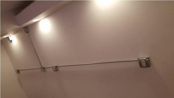 Электропроводка в трубах на стене