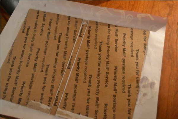Картонная обложка приклеена к обёрточной бумаге